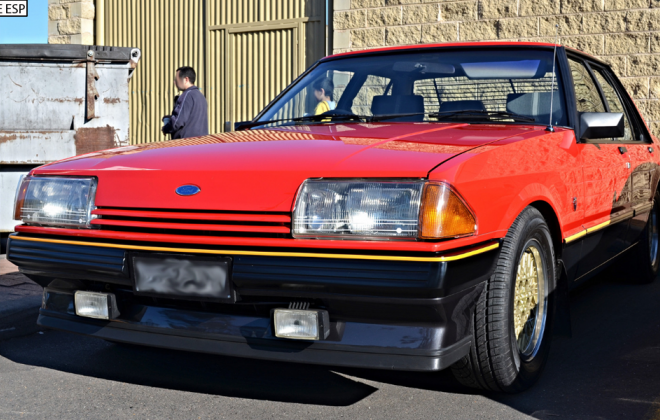 1982 XE ESP Fairmont Ghia Monza Red on CHarcoal.png