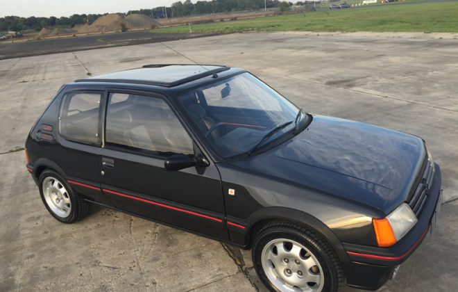 1987 205 GTI with slide back sunroof.png