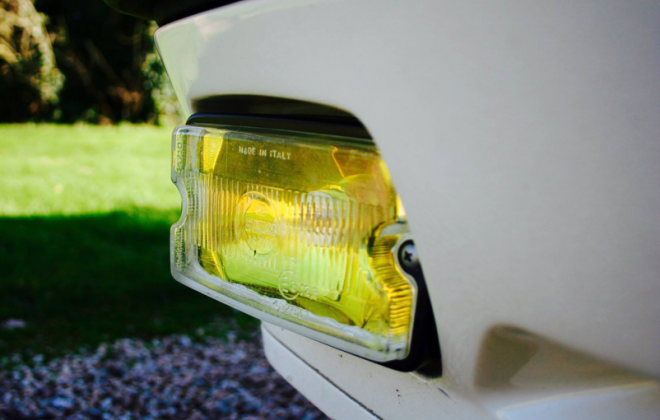 205 GTI Siem driving lights with yellow reflector.png