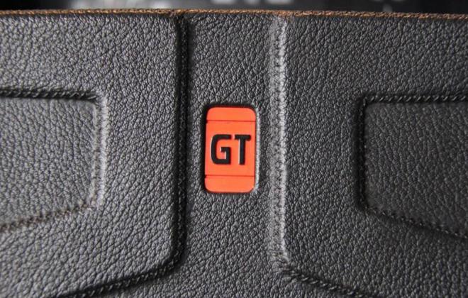 242 GT steering wheel red badge image.png