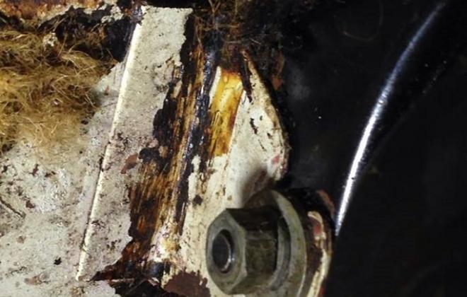 Bracket spot welded to firewall.jpg