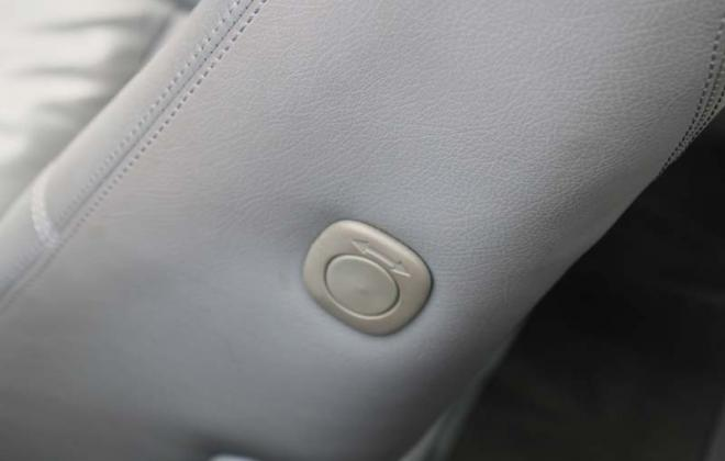 C140 Mercedes front seat side push button to access rear seat image.jpg