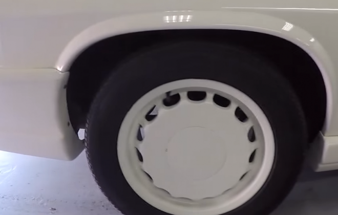 Car with white wheels.png