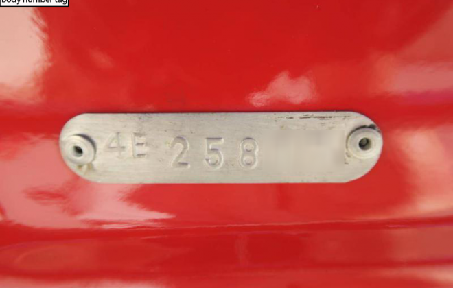 E-Type 1968 Body number tag under number plate.png