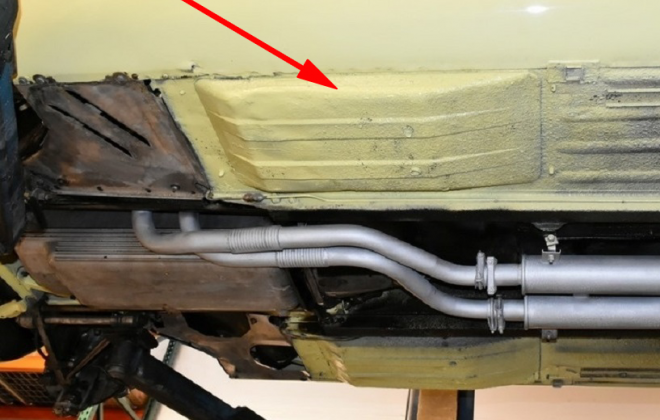 E-Type dished floor pans under car image.png