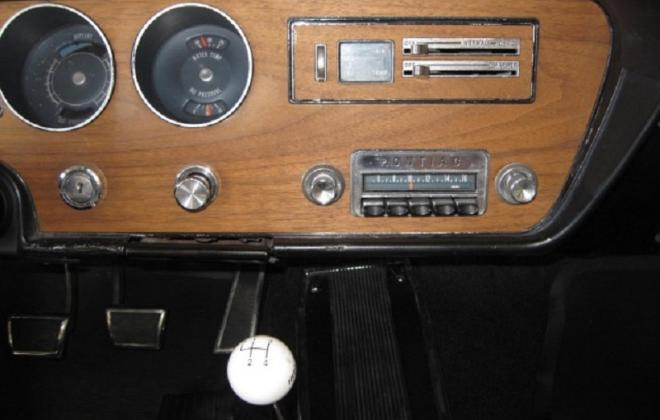 Factory radio and white gear shifter.jpg