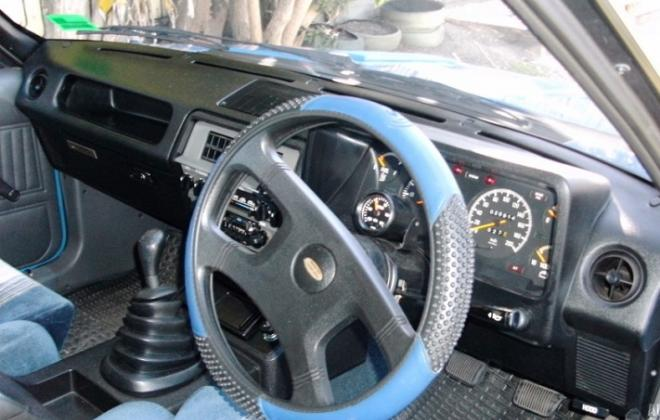 Falcon XE Dick Johnson Grand Prix interior blue grey scheel seats dashboard.jpg