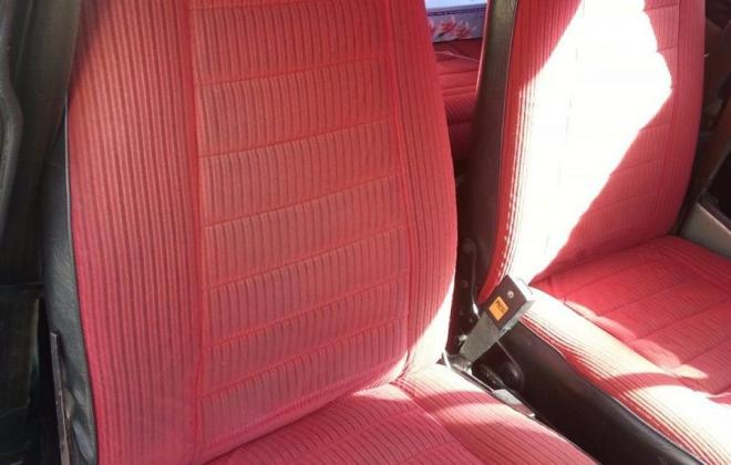 Interior Leyland Mini 1275 LS with red trim and timber dash (2).jpg