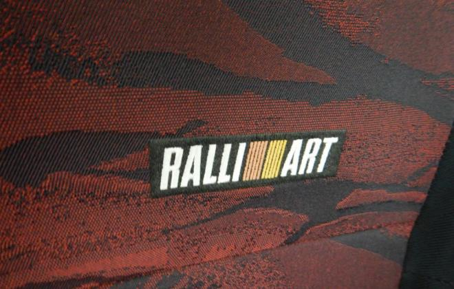 Magna Ralliart interior trim 2002 grey and red cloth (14).jpg
