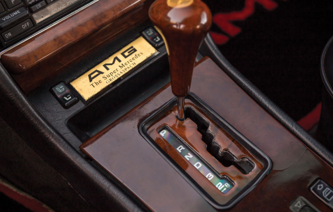 Mercedes 560 SEC 6.0 AMG Widebody console badge.png