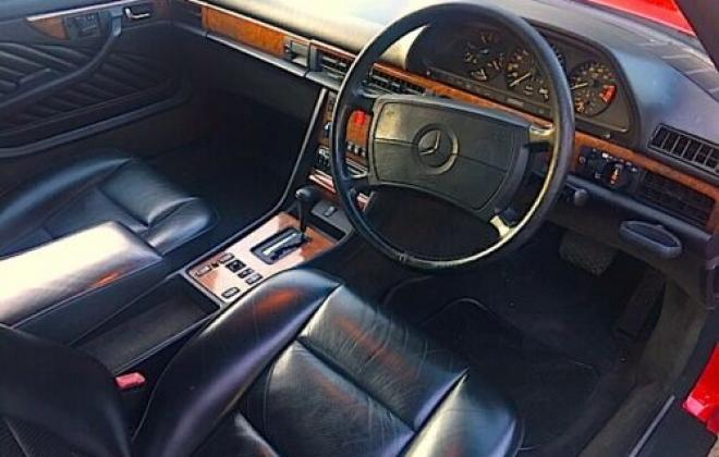 Mercedes 560SEC C126 classic Signal red over burgundy images (4).jpg