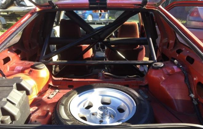 Mitsubishi Starion GSR Turbo Red race prepared roll cage (3).jpg