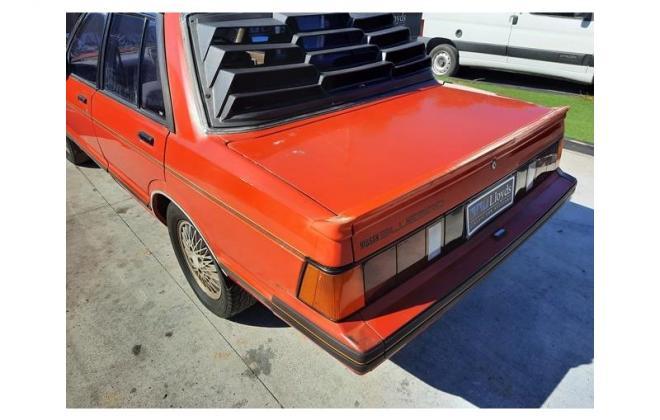 Nissan P910 TR-X TRX 1984 sedan red images  (15).jpg