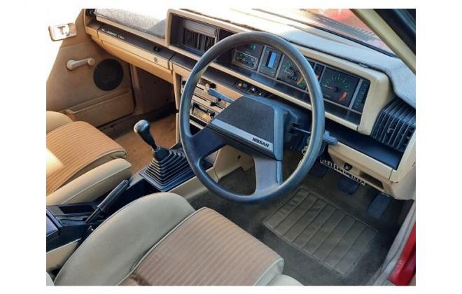 Nissan P910 TR-X TRX 1984 sedan red images interior (4).jpg