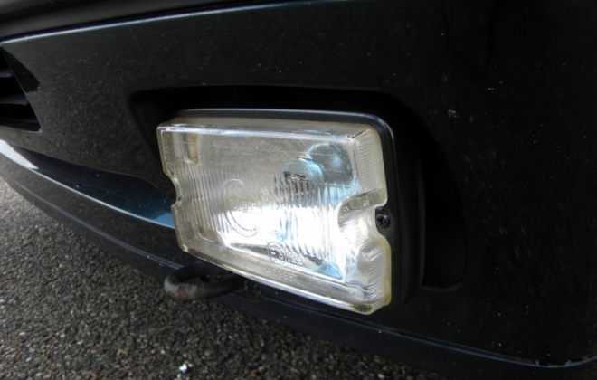 Peugeot 205 GTI Siemdriving lights clear lens up close.png