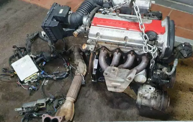 Proton Satria GTi engine and gearbox out of car image.png
