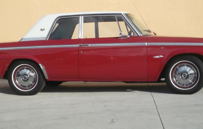 Red Studebaker Sports Sedan side image white roof.png