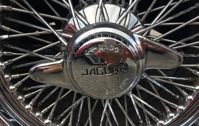 Series 1 E-Type Jaguar XK-E wheel nut spin on wing.JPG