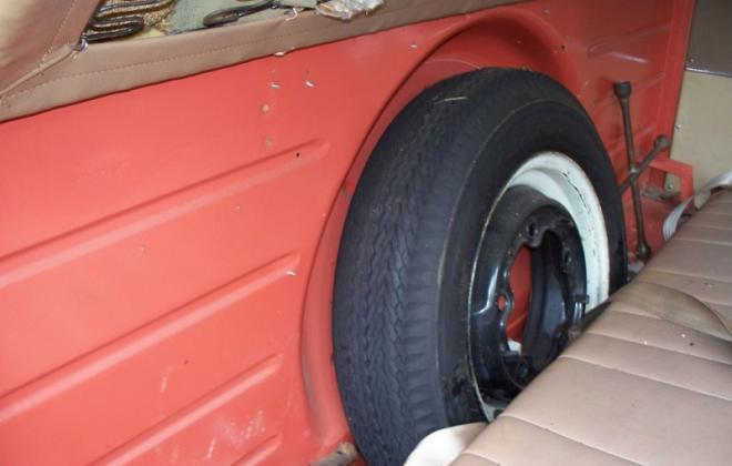 Spare wheel behind front seat in Volkswagen Deluxe Microbus.jpg