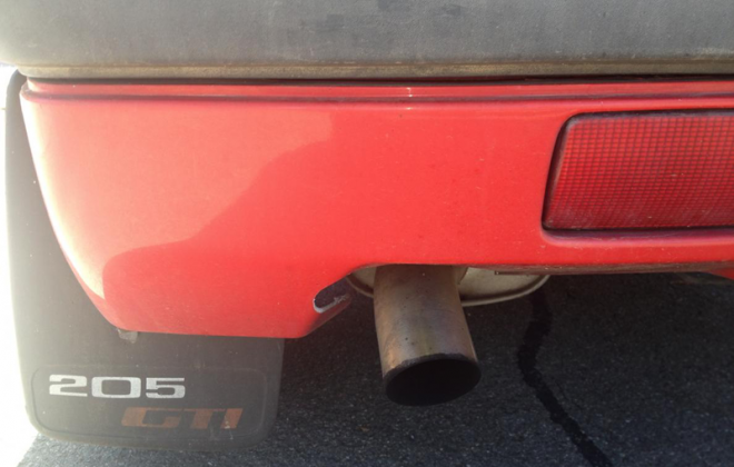 Stock exhaust and optional 205 GTI mudflaps.png