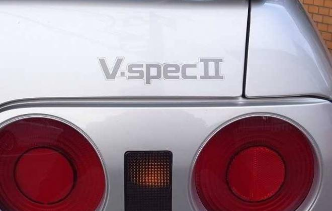 V spec badge on silver car.jpg