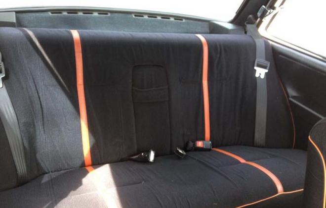 Volvo 242 GT rear seat trim black with red stripe.jpg