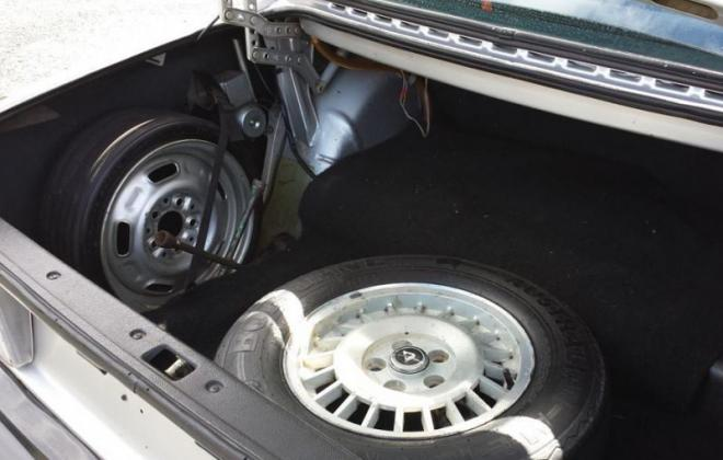 Volvo 242 GT trunk with space saver spare wheel.jpg