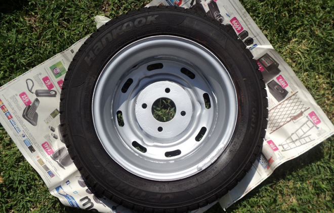 Wheel with backing plate Leyland Mini GTS south africa.png