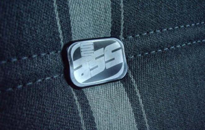 XE ESP Fairmont Ghia Scheel seats badge.png