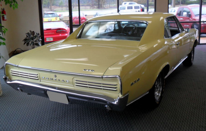 cream 1966 Pontiac GTO Sports Coupe.png