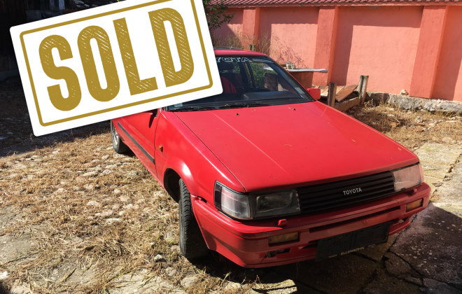Sold 1983 Toyota AE86 red hatch zenki.png